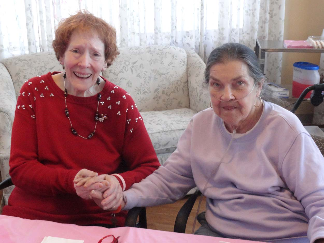 Bristol Home Assisted Living Residents sitting at table during valentine's day event.